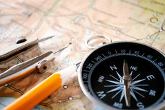 Compass and pencil on a map Stock Images