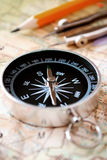 Compass and pencil on a map Royalty Free Stock Image