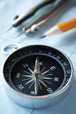 Compass and pencil on a map Stock Image