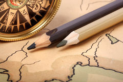 Compass and pencils on old map. Compass and pencils on old contoured map, shallow DOF Stock Photography
