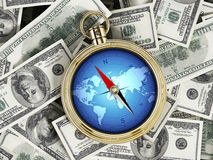 Compass on pile of dollars Stock Photo
