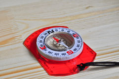 Compass on the pine table. Stock Photo