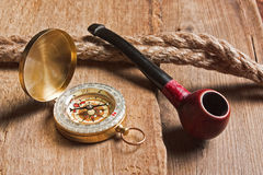 Compass and a pipe with a rope Royalty Free Stock Photos