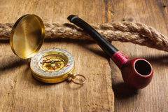 Compass and a pipe with a rope Royalty Free Stock Image