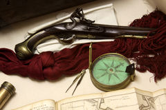 Compass and Pistol. A Victorian era compass and pistol close-up Stock Images