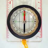 Compass. Plastic map compass showing north south royalty free stock photography