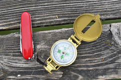 Compass and pocket knife Stock Photo
