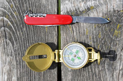 Compass and pocket knife Royalty Free Stock Photo