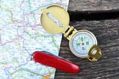 Compass and pocket knife Stock Photography