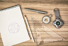 Compass, pocket watch, notepad, ruler, pen and pencil - retro sc Royalty Free Stock Photography