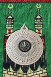 Compass on praying carpet Stock Image