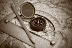 Compass and protractor. On the map royalty free stock image