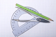 Compass, protractor and pencil Stock Photo