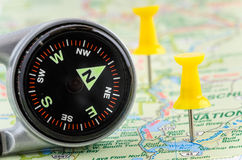 Compass and Pushpins on a Map Royalty Free Stock Image
