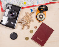 Compass, retro photocamera, passport, map, cockleshell and coins Stock Images
