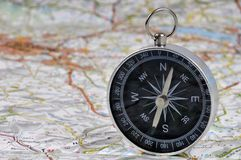 Compass on a road map royalty free stock photo