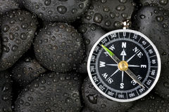 Compass with rock Stock Photo