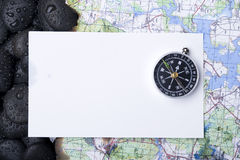 Compass with rock Stock Photography