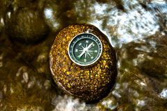 Compass on the rock Royalty Free Stock Photography