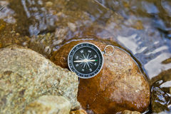 Compass on the rock Stock Images