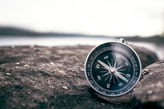 Compass on rock in the nature royalty free stock photography