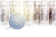 Compass On Roll Of Yen Banknote. Concept And Idea Of Direction And Money, Business And Finance Concepts, Money market in Asian Royalty Free Stock Image