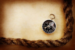 Compass and rope Royalty Free Stock Photography