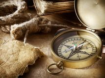 Compass, rope and book stock images