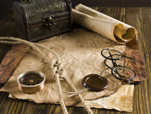 Compass, rope and glasses on old paper Royalty Free Stock Images