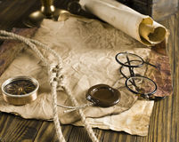 Compass, rope and glasses on old paper Royalty Free Stock Photos
