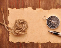 Compass and rope on grunge background Stock Photography