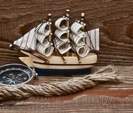 Compass, rope and model classic boat Royalty Free Stock Photo