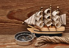 Compass, rope and model classic boat Stock Photos