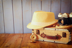 Compass, rope old camera and fedora hat. explorere concept Stock Image