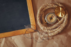 Compass, rope, old glasses and blank blackboard Royalty Free Stock Photos
