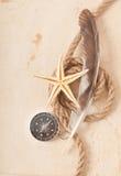 Compass, rope and starfish Stock Photos