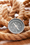 Compass and rope in travel   concept Stock Photography