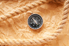 Compass and rope in travel  concept Stock Images