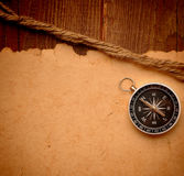 Compass and rope on wood background Stock Image