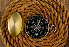 Compass and rope Stock Images