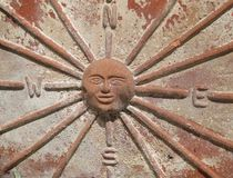 compass rose or compass card with the sun in the centre on a ceramic plantpot royalty free stock image