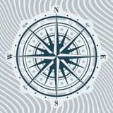 Compass rose over background with waves Royalty Free Stock Photography