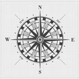 Compass rose over grid. Royalty Free Stock Image