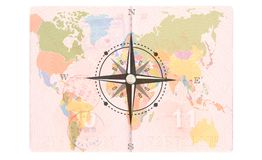Compass Rose in the Passport. World map, Travel concept.  stock photo