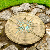 A compass rose in a small park next to York's Medieval City Walls. Stock Photo