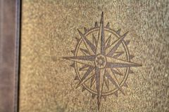 Compass rose on wood texture Stock Images