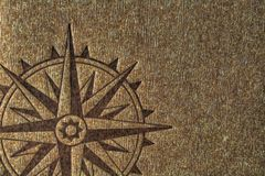 Compass rose on wood texture Stock Photography