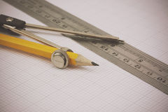 Compass and ruler on graph paper Stock Image