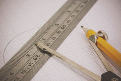 Compass and ruler on graph paper Royalty Free Stock Images