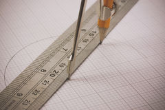 Compass and ruler on graph paper Royalty Free Stock Photos